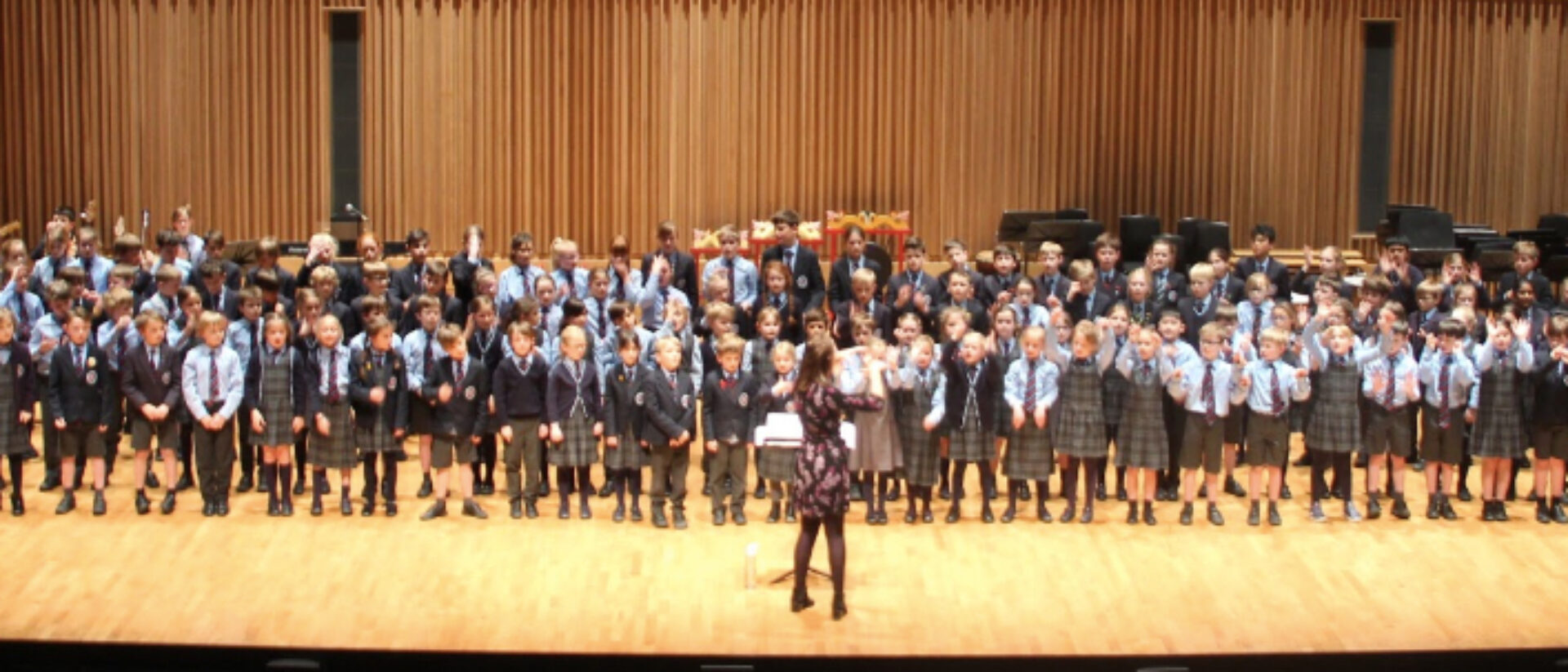 School children performing on stage
