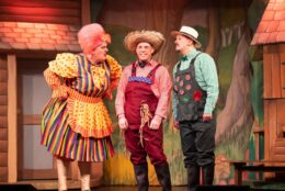 A few characters of the Wizard of Oz on stage.