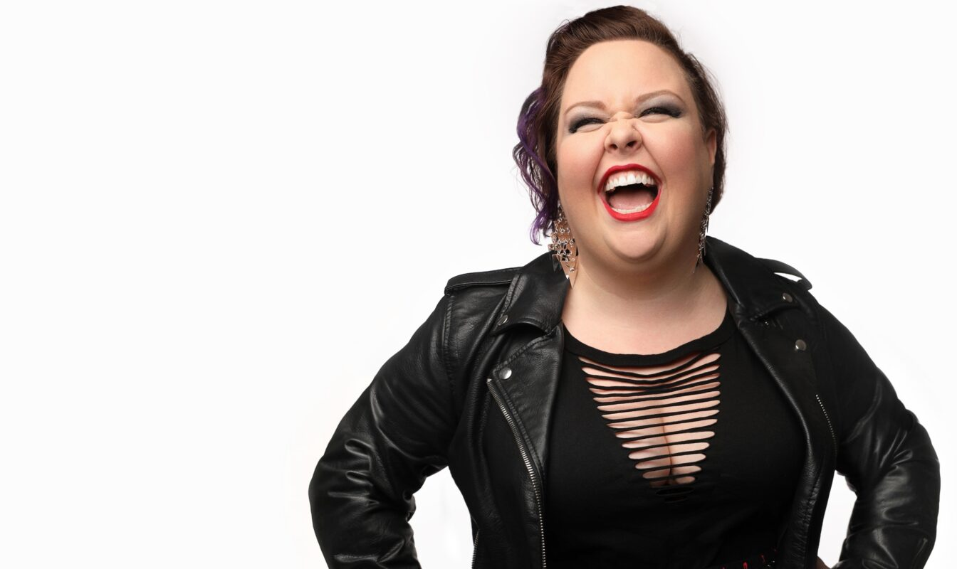 Jamie Barton laughs against a white background