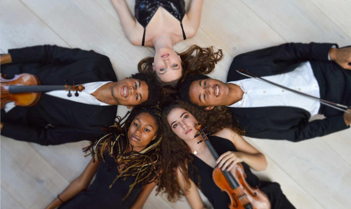 Sheku Kanneh-Mason and friends lie on the ground in a circle holding their instruments
